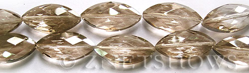 Tiaria Glass Crystal 69-Tan Color marquise spindle Beads <b>26x12mm</b> faceted     per   <b> 7-pc-str	</b>
