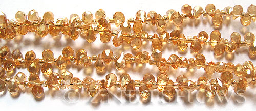 Tiaria Glass Crystal 94-Amber Gold teardrop Beads <b>9x6mm</b> faceted tip-drilled    per   <b> 100-pc-str</b>